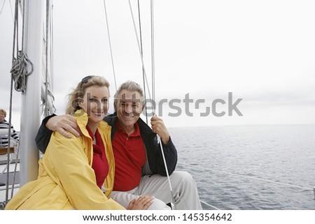 Couple on yacht portrait - stock photo