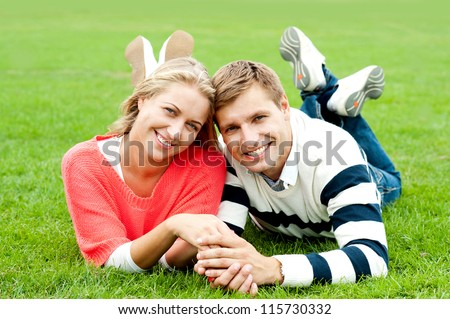 Couple outdoors enjoying the fresh air. Facing camera with a smile - stock photo