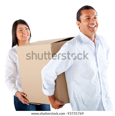 Couple packing in boxes to move house - isolated over a white background - stock photo