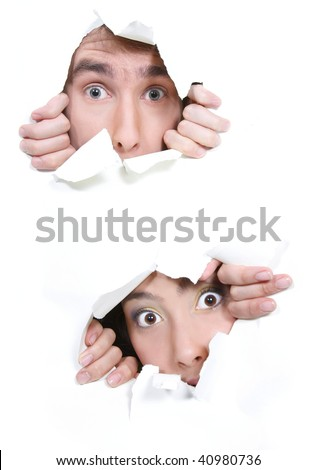 couple peeping through hole in white paper - stock photo