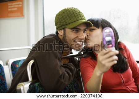 Couple photographing themselves - stock photo