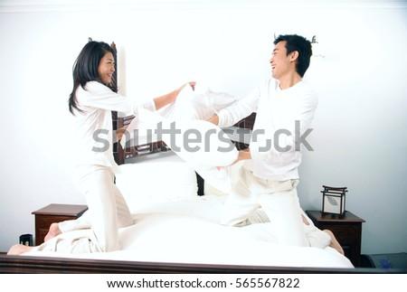 Man Using Birthday Cake As Pillow Stock Photo