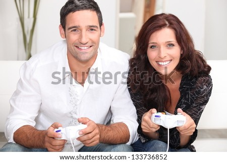Couple playing computer games - stock photo