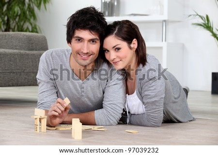 Couple playing dominoes