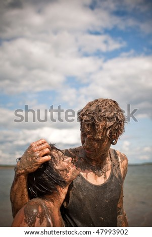 couple playing in the mud