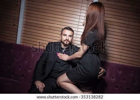 Couple playing. Woman sitting on man. Passion between lovers. Girl sitting on boy. Intimacy between boyfriend and girlfriend. - stock photo