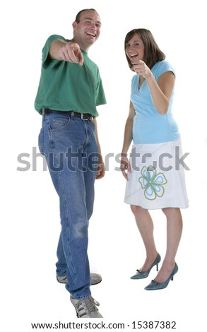 Couple pointing and laughing. - stock photo