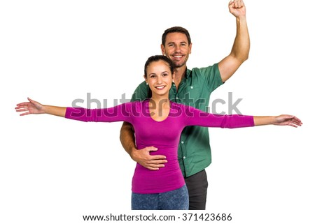 Couple posing for camera on white screen - stock photo