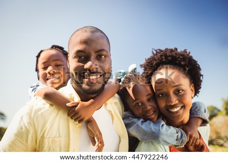 Couple posing together with their children at park