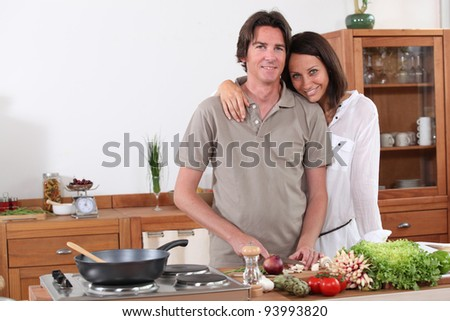 Couple preparing dinner in the kitchen - stock photo