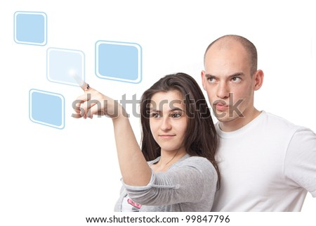 Couple pushing icons on a virtual touch interface - stock photo