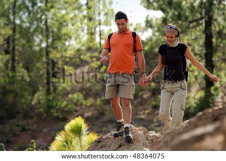 Couple rambling in a forest - stock photo