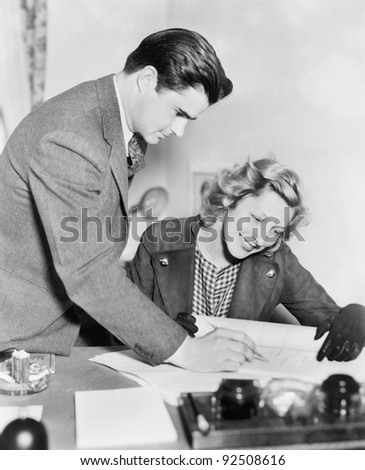 Couple reading a document together - stock photo