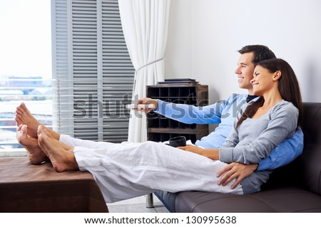 Couple Reaxing Watching Tv Home On Stock Photo (Royalty ...