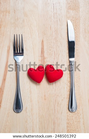 Couple Red Heart with Spoon and Fork on Wooden Table (Top View) for Valentine's day - stock photo