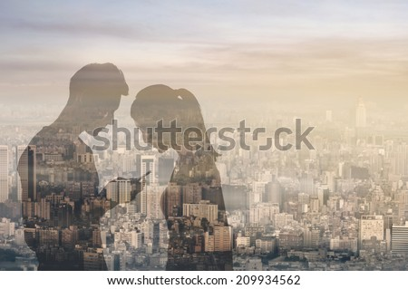 Couple reflection on window glass in sunset city, concept of couple, connection, relationship etc. - stock photo