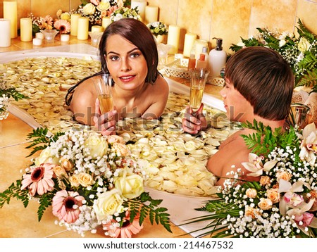 Couple relax  at luxury spa with flower. - stock photo