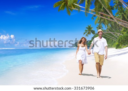 Couple Relaxing Beach Summer Honeymoon Island Concept - stock photo