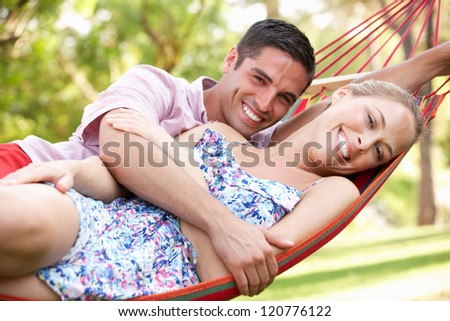 Couple Relaxing In Hammock - stock photo