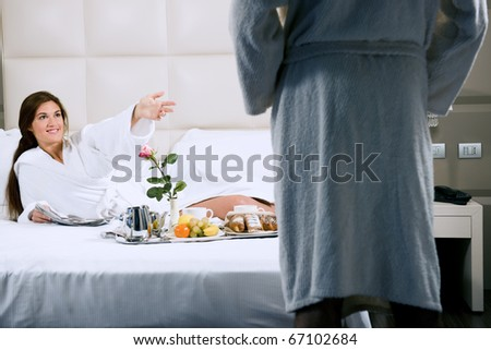 Couple relaxing in hotel - stock photo