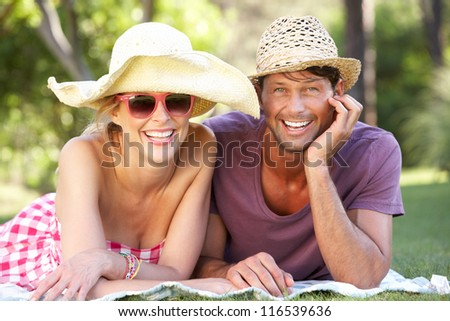 Couple Relaxing In Park Together - stock photo
