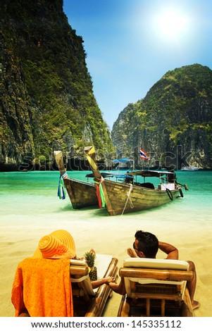 Couple relaxing Maya bay Phi Phi Leh island, Thailand - stock photo
