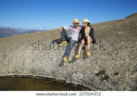 Couple Relaxing on Hill