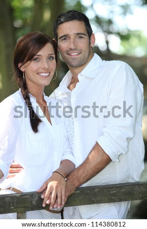 Couple relaxing outside - stock photo
