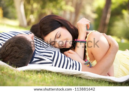 Couple Relaxing Together In Garden - stock photo