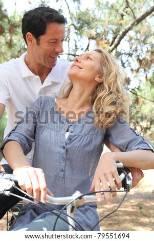 Couple riding bikes - stock photo