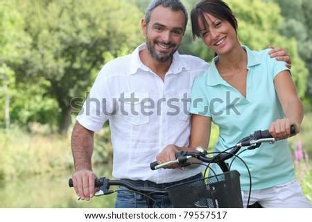 Couple riding bikes - stock photo