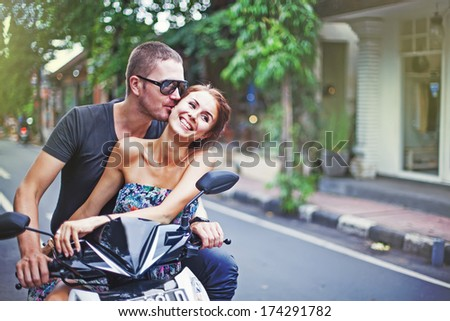 couple riding motorcycle - stock photo