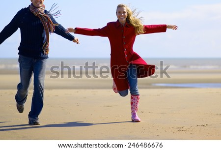 couple running on beach training  - stock photo