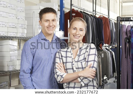 Couple Running On Line Fashion Business - stock photo