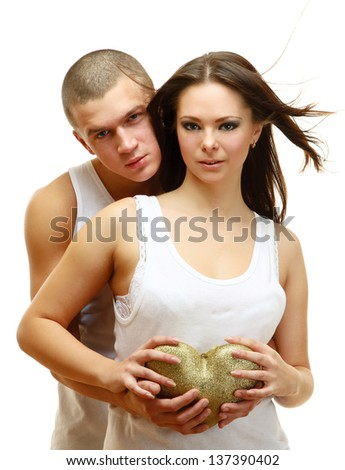 Couple Sexy holding gold heart, isolated on white background - stock photo