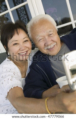 Couple Sharing Cell Phone - stock photo