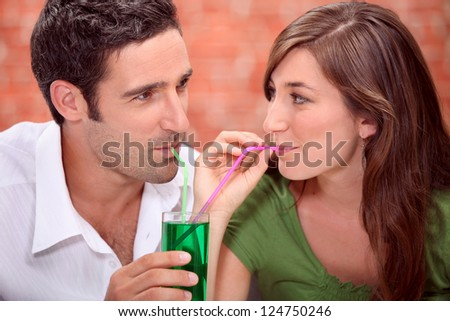 Couple sharing drink