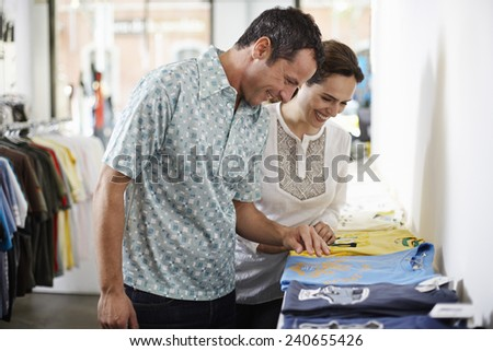 Couple Shopping at Clothes Store - stock photo