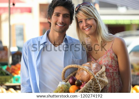 Couple shopping at the local market - stock photo