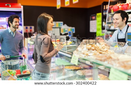 Couple shopping at the supermarket - stock photo