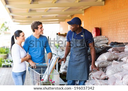 couple shopping for garden stones in hardware store - stock photo