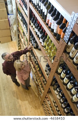 Couple shopping for wine - stock photo