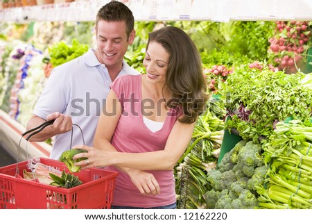 Couple shopping in supermarket produce section