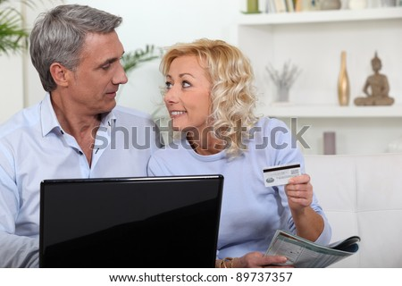 Couple shopping on-line - stock photo
