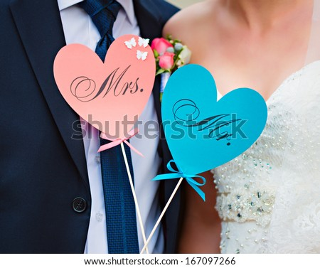 Couple show hearts card with text MR and MRS - stock photo