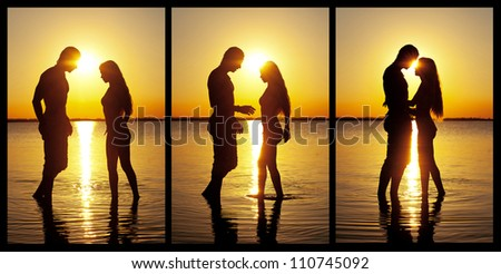 Couple silhouette at the beach kissing each others. - stock photo