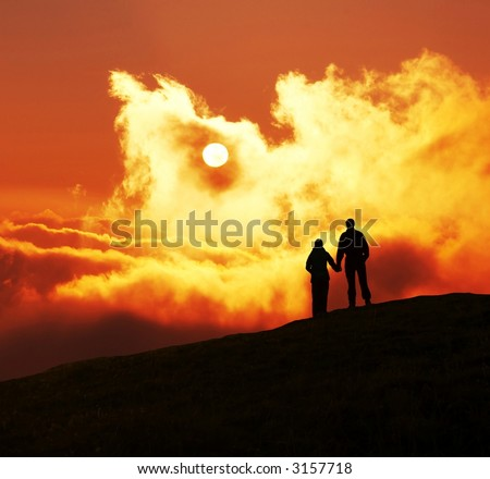 Couple silhouette on sunset