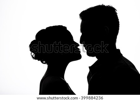 Couple  silhouettes of kissing people on the back light background. Valentine's Day