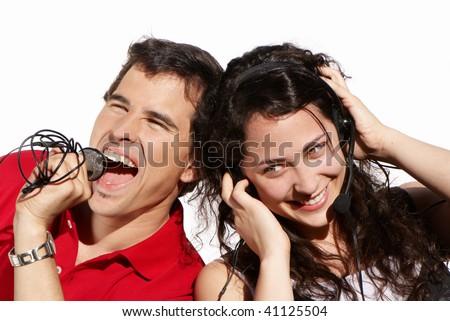 Couple singing karaoke isolated on white background - stock photo