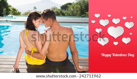 Couple sitting by swimming pool on a sunny day against happy valentines day - stock photo